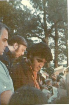 Elvis signing autographs at Graceland (shown in photo is Lamar Fike and Marty Lacker with the Memphis Mafia)
