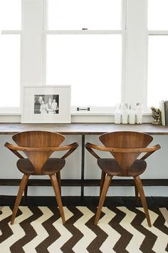Love the unexpected combination in this space. These chairs remind us of our chic Harvey chairs.
