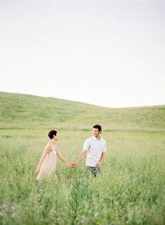 Gorgeous green grass field + loving couple! Image by Jose Villa.