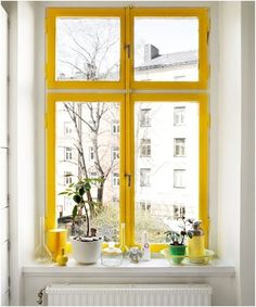 Cheery yellow window mullions guarantee a sunny outlook—even on the cloudiest of days. Image styled by Tina Hellberg for Elle Interior.
