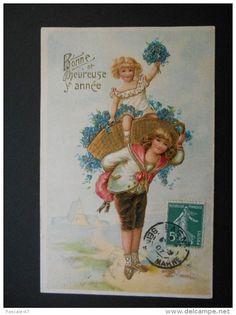 Enfants - petit garçon portant petite fille dans panier doré plein de myosotis - Bonne et heureuse année -dorure-gaufrée