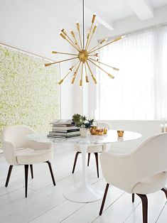 """Saarinen Dining Table and Executive Armchairs shown with Satellite Chandelier #dwrdining    """"I love this image. It's elegant and captures the timelessness of modern design. The table and chairs were designed by Eero Saarinen in the 1950's and have never looked fresher.""""   - John Edelman  President+CEO, Design Within Reach"""