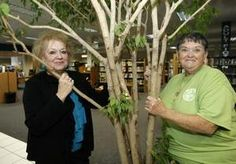 Some of these Master Gardeners met recently at the local library to discuss the big day.    They are seen here with one of the library trees that they care for.