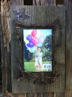 Hand made reclaimed barn wood and rusted barbed wire photo frame