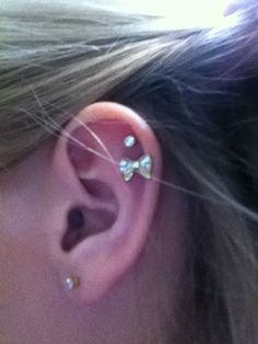 Lobe and double cartilage with diamonds and a bowww(: