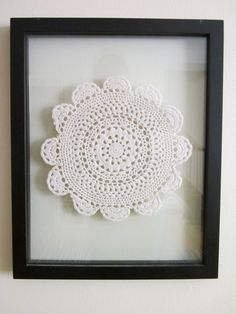 Framed doily... I wanna do this with my great grandmother's dolly.  Its to fragile to use and it gives me no pleasure in storage