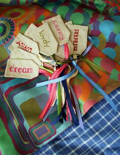great idea for gift tags from fabric (no directions, just inspiration); this is a retail item from by Etsy store deepindigo