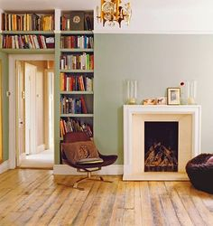 Built in book shelves and a wood burning fire place are all you need for a perfect living room.