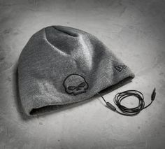 Features a pair of speakers built right in –– just connect the cord to your device. This warm men's knit hat is so unique it just might be worthy of its very own playlist. | Harley-Davidson Men's Speaker Knit Hat