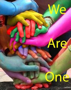 We are ONE--hands literally of a different color join together in a pile of unity