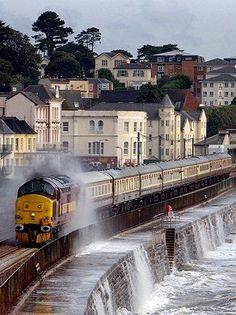 Surf crashes over seawall onto train engine - Cornwall UK