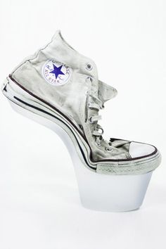 Heel-less Converse Shoe—What Daphne Guinness might have worn in college. High Heeled Converse All Star, image via Virtual Shoe Museum. #refinery29 http://www.refinery29.com/20-of-the-weirdest-footwear-we-could-find#slide-4