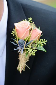 boutonniere of peach roses, blue thistle, and seeded eucalyptus. | Photo by Catrina Earls Photography