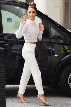 vanessa hudgens style. All white, crop top, top knot