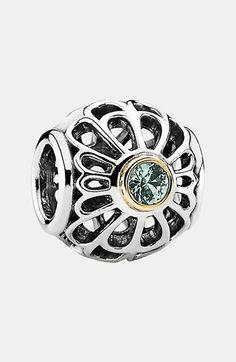 silver with gold trim & light green stone Pandora charm.