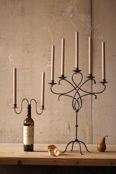 iron candleholder bottle stopper