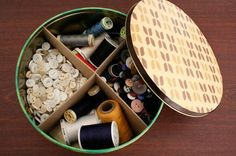Design*Sponge» Blog Archive» diy wednesday: cookie tin storage bins  When I first saw the thumbnail I thought these were hatboxes, cookie tins work too. I love the idea of cordoning space inside each one and making each tin its own organizational masterpiece.