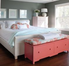Guest bedroom cute and clean. Love the coral chest at the foot of the bed