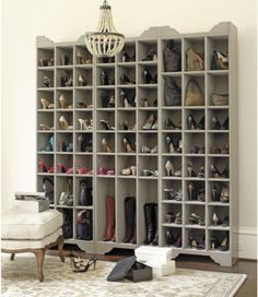 Could create something similar using the Billy bookcases from Ikea. Seems like a large piece to have in a small home, but if you have a lot of shoes, they will take up less space vertically, than on the floor (or in baskets). Plus it is aesthetically pleasing (at least to a shoe lover).
