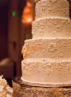 "One Four Seasons LA couple enjoyed this four-tiered cake ""decorated with an elaborate filigree design"" via Inside Weddings. #luxbride"