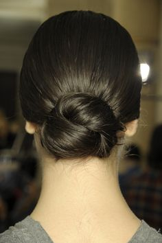"""Loewe Spanish crimson lips, statement arches and flamenco-dancer hair. This tight, center-parted style paired nicely with the Spanish-vibe collection. """"We pulled hair over the ears to create more character for this rich, elegant look,"""" said Guido. Spanish Hairstyles, Low Bun Hairstyles, Formal Hairstyles, Hairstyles 2016, Too Knot Bun, Dancer Hairstyles, Competition Hair, Medium Hair Styles, Long Hair Styles"""