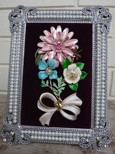 On SALE! This lovely 5x7 faux pearl frame holds the vintage shabby chic jewelry on a bed of burgundy velvet. The opening in the frame is 4x6.