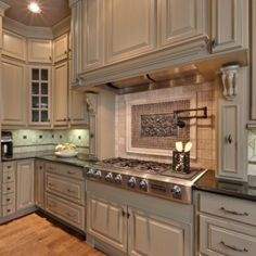 floor to ceiling cabinets with crown molding water faucet over stove viking range