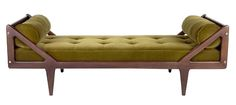 The Charles Daybed features a hand carved frame with exposed bolts and an attached tufted mattress with two bolster pillows. The Charles Daybed is available in a variety of woods, stains and finishes as well as metal options for the bolts. It is fully customizable and also available in a variety of configurations.