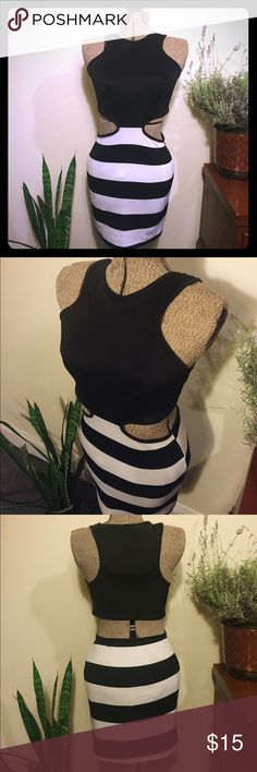 Black and white club dress This dress is a comfortable body-con that accents the body beautifully, and is perfect for a night on the town. The back of this dress is disconnected from the skirt, accentuating ones curves. It is a 95% cotton 5% spandex blend. Shows minor signs of wear. Misope Dresses Backless
