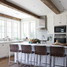 Island and leather stools.  Houzz.