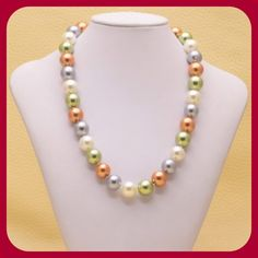 Host Pick Excellent Tridacna Shell Necklace PRICE FIRM UNLESS BUNDLED ‼️ Multi color Tridacna shell comes from a clam. These are 12mm shell beads. Has a large lobster clasp 18K WGP. All my gems come from a USA wholesaler. NWOT from wholesaler. Check out my other items for a bundle discount. Jewelry Necklaces