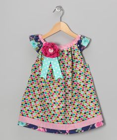 With fluttery sleeves, an airy silhouette and an elastic neckline, this playfully patterned frock makes a smooth addition the wardrobe. The flowery ribbon embellishment offers a sweet touch.100% cottonMachine wash; hang dryMade in the USA