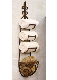 "Rusted Metal Towel Rack with Rounded Basket Handcrafted of heavy iron. Great eye catching bathroom accessory.Dimensions (in):12"" x 7 1/2"" x 41""tBy Kalalou - Kal"