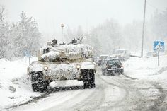 A Leopard 2 a4no main battle - drive along the E-6 in Troms county during winter exercise Cold Response 2014. Photo: Torbjørn Kjosvold