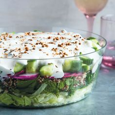 This Middle Eastern Seven-Layer Salad recipe is the perfect potluck dish.