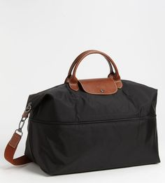 Longchamp Travel Bag. I've had mine for 20 years and it still serves me well.