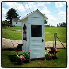 I got this idea from Pinterest. My local Habitat for Humanity Restore shop had the doors, hubby had the tin for the roof-- love it!!