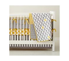 The combo of yellow and gray is a hot color choice right now, and this modern, gender-neutral set will last you from one to three kids! Price varies by piece $24 to $79.  by Christine Fox