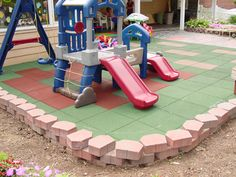 Rubberized Flooring. I would love an area like this in our backyard.