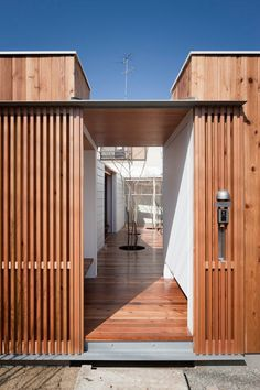 """Entry experience """"Once the lattice door is opened, you eye a pathway to the open courtyard filled with trees."""" Designed by Kazuhiko Kishimoto / acaa"""