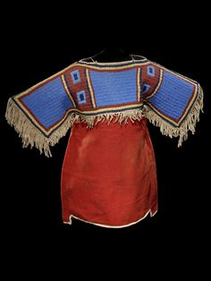 Girl's dress, Sioux, circa 1900, Hide, wool cloth, glass bead/beads, muslin, sinew. Sewn, lazy/lane stitch beadwork.