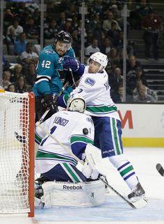 San Jose Sharks forward Matt Pelech makes a strong move towards the net (Oct. 3, 2013).