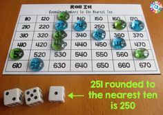 In this Roll It! Rounding Game, round the number rolled to the nearest ten.