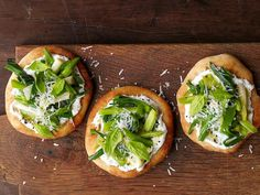 Spring Pizzas: Alex Guarnaschelli cuts down on prep time by starting off with store-bought pizza dough for her mini rounds. Top them with a spring medley of ramps or scallions.