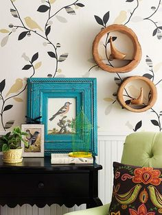 A turquoise frame and green wire birdcage add splashes of color to the otherwise neutral display.