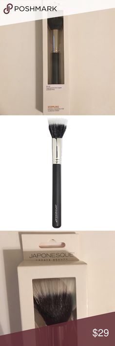 """Japonesque Pro Stippling Brush Duo Fiber New! This brush is perfect for blending face products, wet or dry, into the skin for a flawless finish. Synthetic fibers extend past the goat hairs to pick up two layers of product, which translates into a satiny appearance. The two levels of bristles let you layer product beautifully €""""and determine how sheer or heavy you want your coverage to be. The synthetic Taklon hairs allow you to use it with wet, creamy or dry products like compact foundation…"""