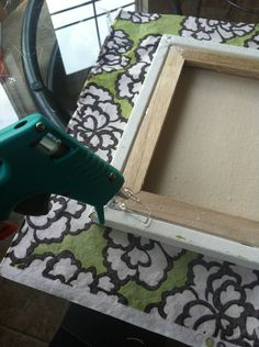Fabric covered canvas - a cheap & easy way to give your walls your own original flair.