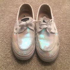 Sparkly sperrys Super cute sparkly white sperrys with a pink undertone. Slight wear and tear. Worn less than a dozen times Sperry Top-Sider Shoes Flats & Loafers