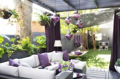Another view of the purple accented outdoor living space by Brian Patrick Flynn.  But damn! The purple glass pendant lights are $80 each.