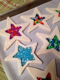 2C flour,1C salt,1C water, transparent pony beads,parchment paper on cookie tray,2 cookie cutter 1 large,1 small Mix flour,salt & water Roll out dough Make shapes use lrg cookie cutter & small cutter for centers Remove dough from middle Use toothpick for hanging Put on pan Fill middle stars w\beads w\no space between beads. Loosely cover w\tinfoil Bake 375F  1- 11\2 hrs so beads are melted & light to drk brn